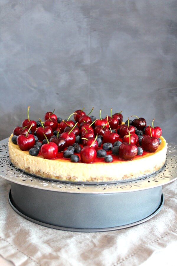 Baked Vanilla Cheesecake with Cherry Coulis. You won't believe how creamy & melt in your mouth this baked cheesecake is! It's super easy to make & absolutely perfect as a Christmas dessert   berrysweetlife.com