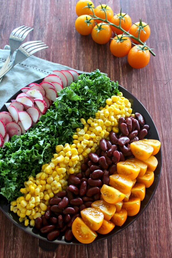 Mexican Chopped Corn, Vine Tomato & Kale Salad. A simple & tasty recipe with a Lemon & Honey Olive Oil Dressing. Perfect for a light lunch or as a side salad. The whole family will love this! | berrysweetlife.com
