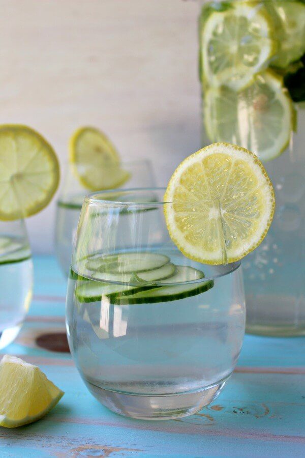 Lemon Basil Cucumber Infused Water. A refreshing summer drink perfect for a hot day by the pool! Such a healthy way to quench your thirst | berrysweetlife.com