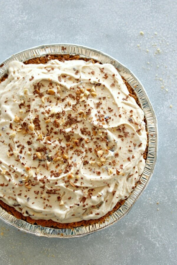 Chocolate Chip Peanut Butter Ice Cream Pie. An easy to make HEAVENLY Indulgence! Made with a tub of vanilla ice cream, nut butter, chocolate chips and a biscuit base, perfect for summer get togethers! | berrysweetlife.com