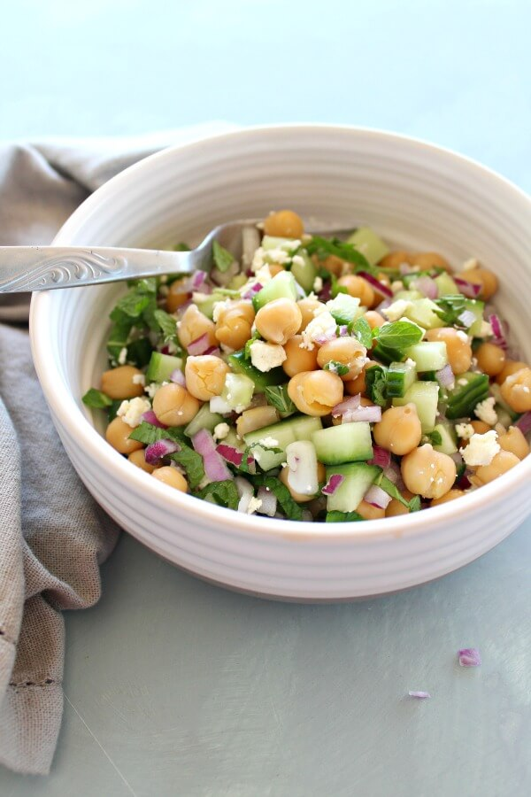 Clean Eating Cucumber Mint Chickpea Salad. A 15 Minute nutrient rich salad that is full of vitamins and protein. A flavourful vegetarian or vegan dish perfect for any occasion | berrysweetlife.com