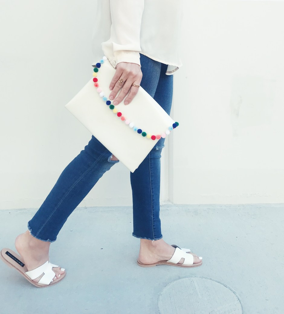 make this DIY pom pom clutch for the perfect spring summer accessory