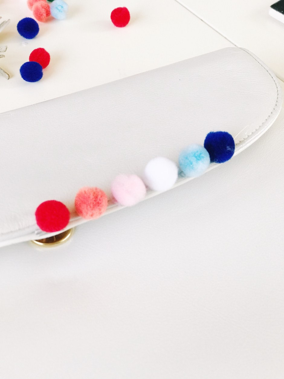 how to make your own rainbow pom pom clutch, easy DIY project for Spring