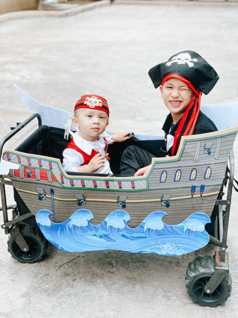easy halloween trick or treating idea pirate ship with pirate costumes for boys