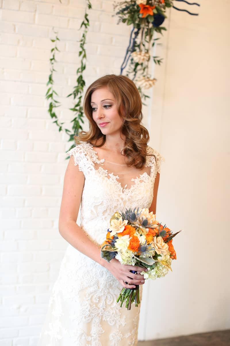 Whimsical Warehouse Wedding Inspiration with Bath tub bride orange navy colour scheme-1
