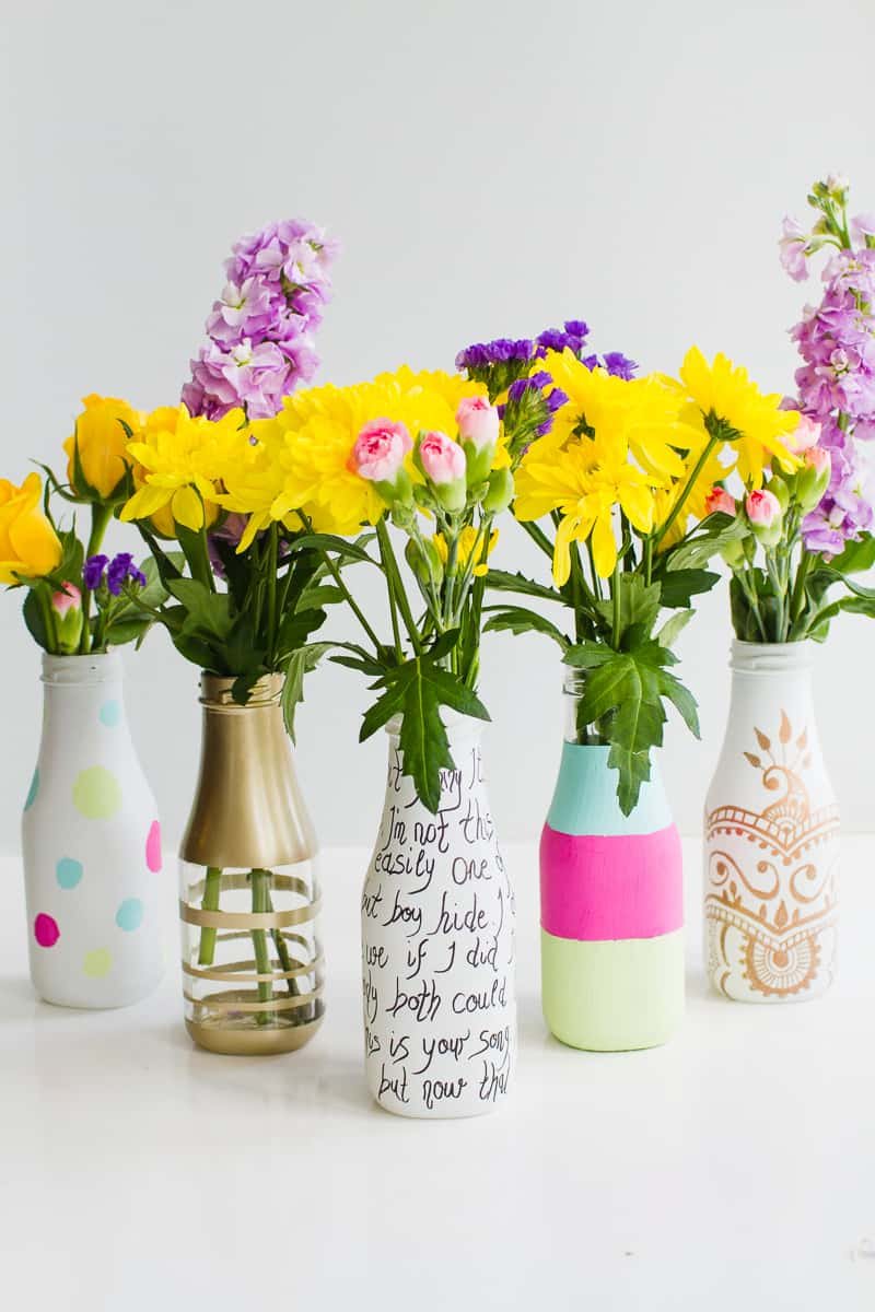 5 ways to decorate leftover bottles for your wedding table decor with paint spray paint sharpies 2