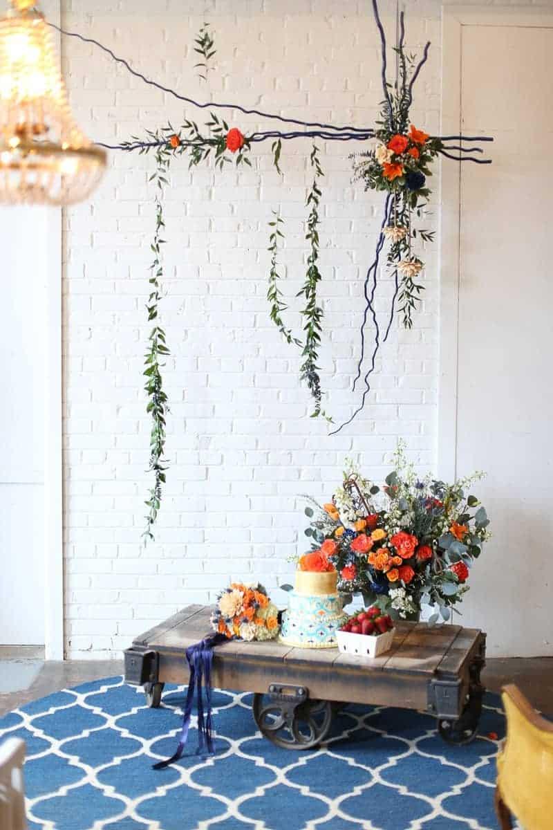 Whimsical-Warehouse-Wedding-Inspiration-with-Bath-tub-bride-orange-navy-colour-scheme-Cool Venues