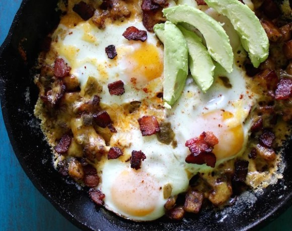 CHEESY GREEN CHILE & CRISPY POTATO BREAKFAST SKILLET