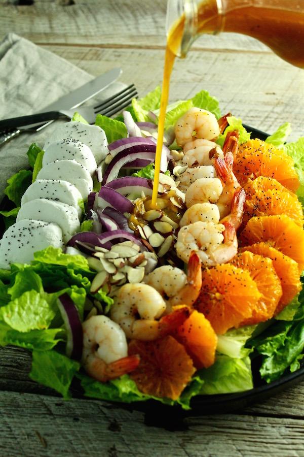 shrimp salad orange poppy seed vinaigrette poured