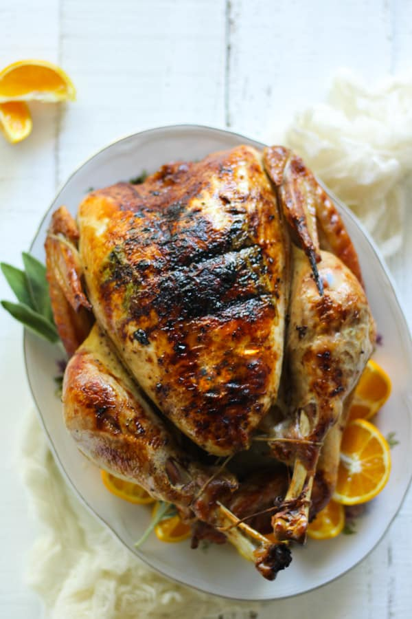 Epic duck fat roasted turkey recipe baked with oranges and fresh sage
