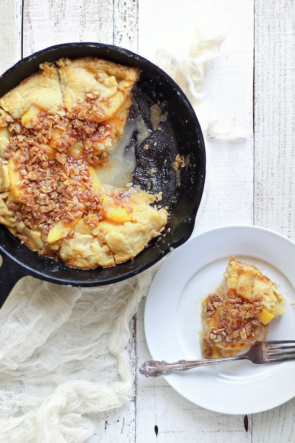 Peach Crostata with Spiced Crumble baked in a cast iron skillet