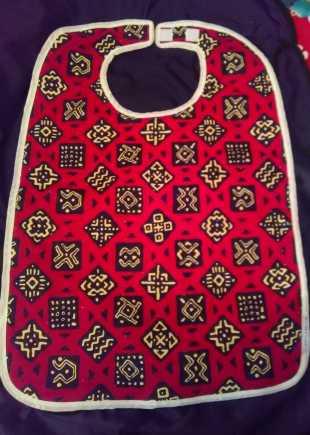 Red black and cream pattern bib