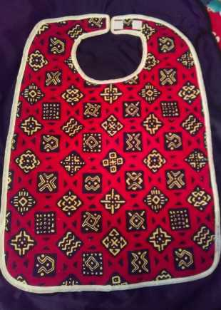Red black and cream pattern bib