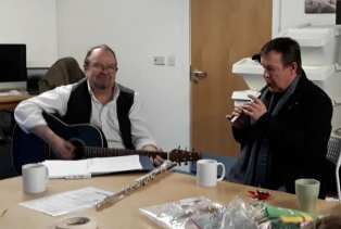 Colin and Steve happily entertaining us while we are sewing