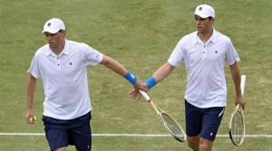 Bob Bryan, left and Mike Bryan of the United States shake hands between points while playing against Australia's Lleyton Hewitt and John Peers during their Davis Cup doubles match in Melbourne, Australia, Saturday, March 5, 2016.(AP Photo/Andrew Brownbill)