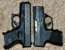 Glock 26 right, Nano left