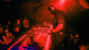 Underground DJ Performing at a Club