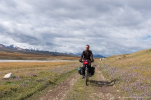 Cyclist on an unpaved road in the Tian Shan Mountains of eastern Kyrgyzstan