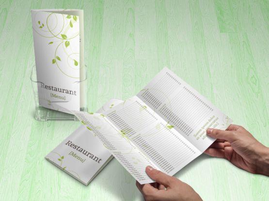 green swirls tri-fold menu holding