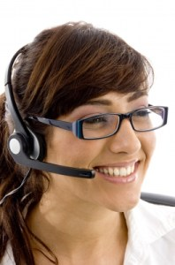 Smiling Mom With Headphone Of Call Center