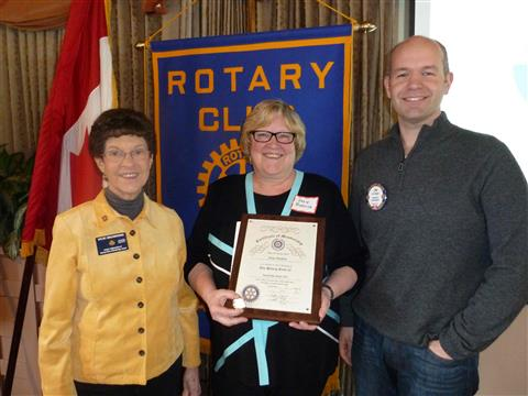 Historical photo shows Susie (center) in March 2013 when she joined the Bainbridge chapter, with sponsors Vicki Browning and Jim Hopper, after 8 years in Seattle Rotary
