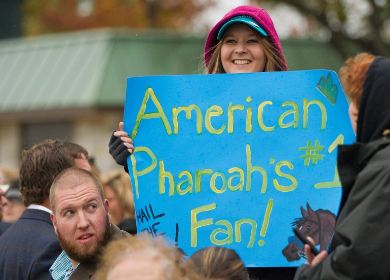 An American Pharaoh fan waves a sign before the start of the Breeders' Cup Classic Saturday. Triple Crown winner American Pharoah, ridden by Jockey Victor Espinoza, won the Breeders' Cup Classic Saturday afternoon October 31, 2015, at the Keeneland Race Track in Lexington, KY during the second day of the 2015 Breeders' Cup. Triple Crown Winner American Pharoah who was broken by J.B. McKathan of Marion County, ran his last race, the Breeders' Cup Classic, before going out to stud. (Doug Engle/Ocala Star-Banner)2015.