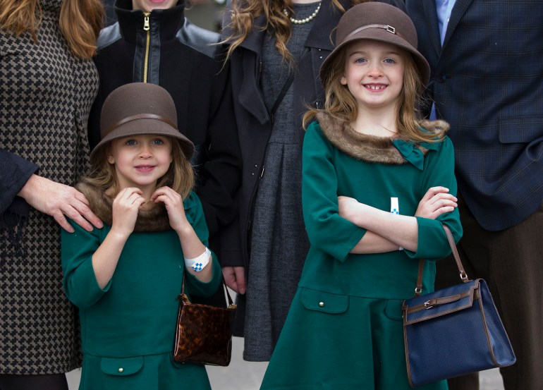 Olivia Meyer, 5, left and her sister Clara Meyer, right, were dressed to the nines in 20's attire with the rest of their family as fans arrived and made their bets for the second day of the 2015 Breeders' Cup Saturday morning October 31, 2015, at the Keeneland Race Track in Lexington, KY during the second day of the 2015 Breeders' Cup. Triple Crown Winner American Pharoah will run his last race, the Breeders' Cup Classic, before being put out to stud. (Doug Engle/Ocala Star-Banner)2015.
