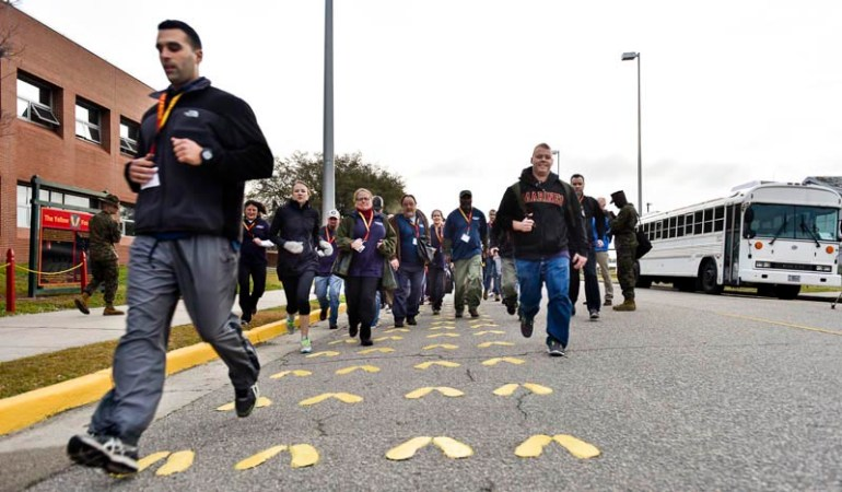 Educators from around New England run back and forth while be put through drills while learning about what life would be like for Marine recruits during the Marine Corps Educator Workshop at Parris Island in South Carolina on Wednesday, Feb. 25, 2015.