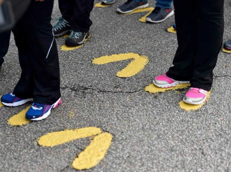 "Educators from around New England stand at attention in the symbolic ""yellow footprints"" upon arriving on Parris Island. Teachers from around New England got a chance to experience what life would be like for Marine recruits during the Marine Corps Educator Workshop at Parris Island in South Carolina on Wednesday, Feb. 25, 2015."