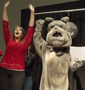 """Centennial High School students Mark Rathbun, in bulldog costume, and Madison Helzer celebrate after """"Spike"""" is named best school mascot during the Best of Pueblo awards ceremony at the Convention Center on Oct. 8, 2014 in Pueblo, Colo. (chris McLean, The Pueblo Chieftain)"""
