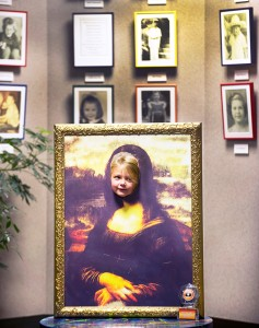 Sophie Grace-Ingo, 4, puts her face through a copy of the famous painting of Mona Lisa during the H2O Picasso exhibit at the Buell Children's Museum in Pueblo Clo. on Sept. 26, 2014. (John Jaques,The Pueblo Chieftain)