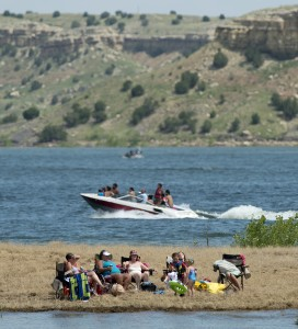 Sunbathers and boaters enjoy the sunshine at Lake Pueblo State Park near the Juniper Breaks Picnic area Friday afternoon July 3, 2015 in Pueblo, Colo. The park is a popular vacation destination and this spring's high water levels haven't kept the crowds away. (Bryan Kelsen, The Pueblo Chieftain)
