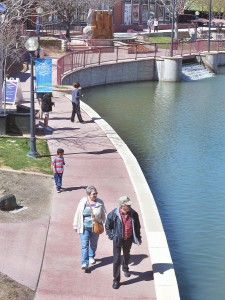 The first day of spring weather brought a lot of people outdoors as they enjoy a strool around the Pueblo Colo. Riverwalk on March, 201 2015. Yhe river canel is full and clean after being dry for its annual cleaning. (John Jaques,The Pueblo Chieftain)