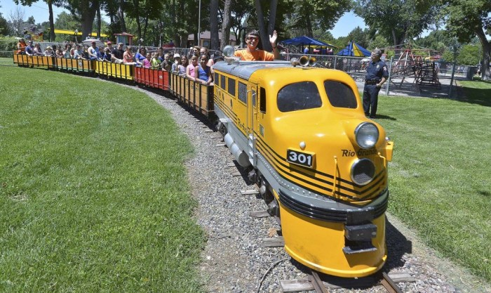 Sean Regalado, train engineer, waves as he gives a large group of people a train ride during the Kick off to a Safe and Drug Free Summer event held in Pueblo Colo. on June, 19,2015 at the City Park. (John Jaques,The Pueblo Chieftain)