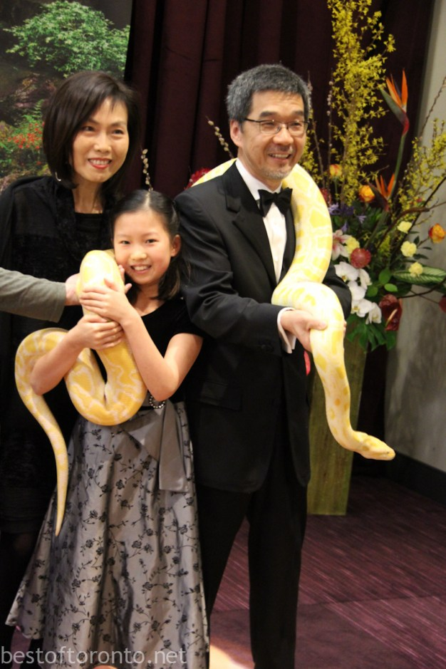 A family photo shoot with a giant snake