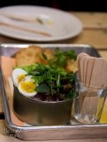 """Can o' Tuna"" Line Caught Ahi Tartare, Quail Egg, Herb Salad, Toast"