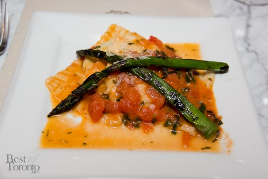 Raviolini stuffed with ricotta and spinach, fresh tomato and basil sauce, topped with sauteed asparagus