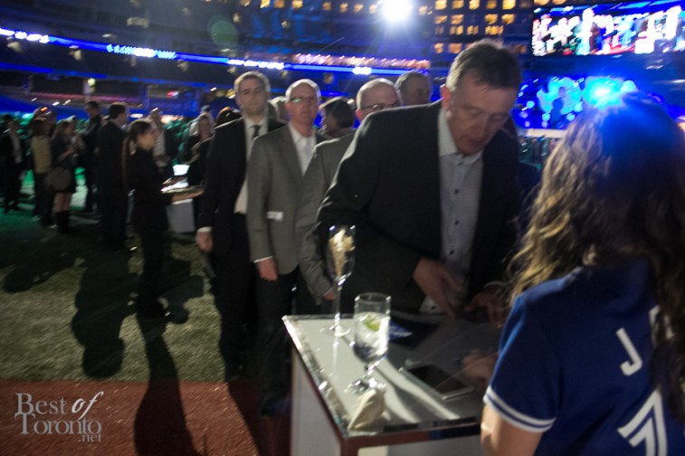 Guests lining up to customize their Blue Jays baseball cap by New Era