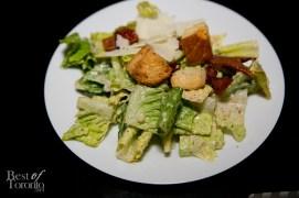 Hearts of Romaine Salad, jalapeno caesar vinaigrette, crispy bacon, candied tomato, grana padano, croutons