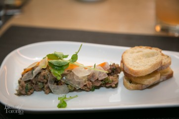 PEI steak tartare topped with pickled carrots and shaved fennel