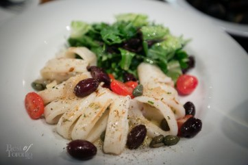 Grilled calamari with caramelized onions, kalamata olives, capers, local grape tomatoes, roasted garlic