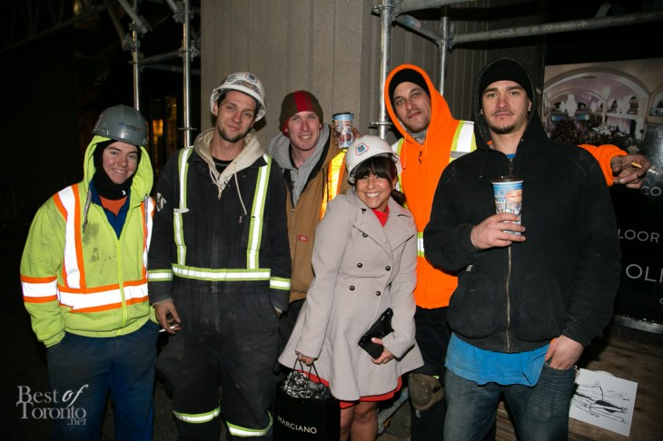 Eryne Ordel mingling with construction workers outside