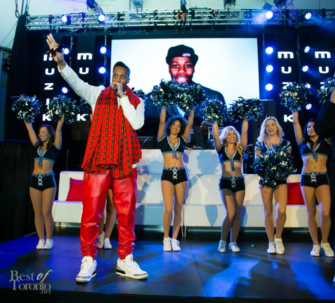 Kardinal Offishall on stage with the Argos cheerleaders