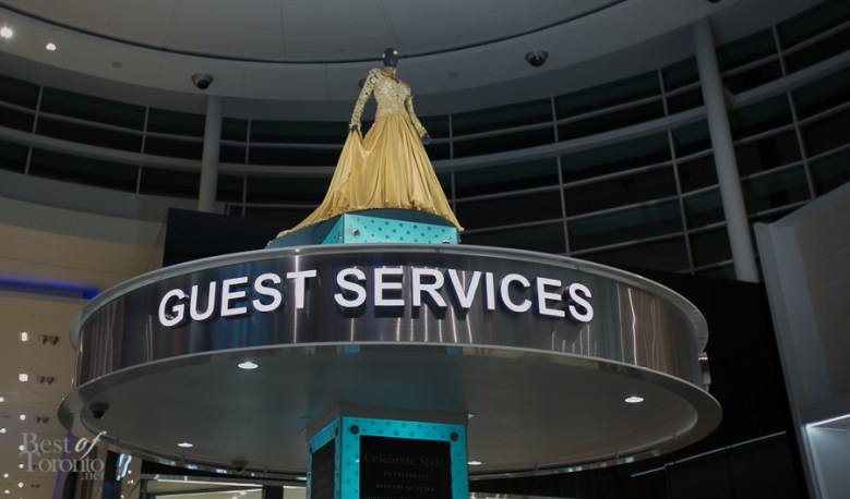 Lucian Matis created this exclusive golden anniversary evening gown to commemorate Yorkdale's 50th. It is displayed on top of Guest Services.