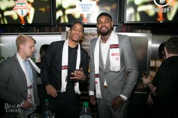 DeMar DeRozan, Amir Johnson of the Toronto Raptors serving drinks at Real Sports Bar