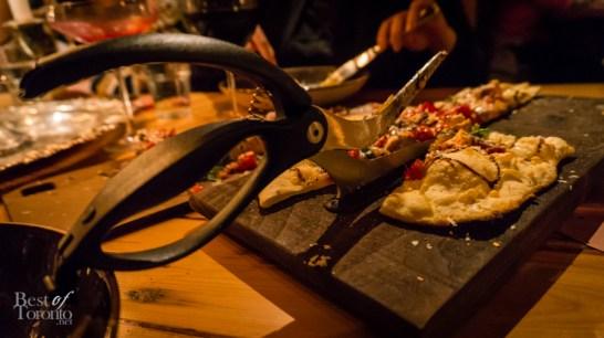 Scizzors cutting through Diavolo Pizza