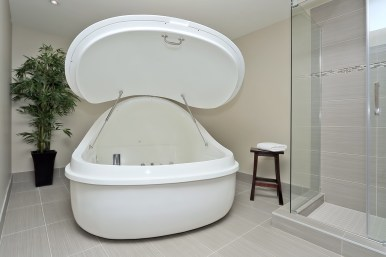Private float suite with a pod and shower at H2O Float Spa