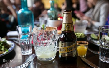 """""""Michelada"""" with Negra Modelo, a dark lager from Grupo Modelo in a salt rimmed glass with ice and lime"""