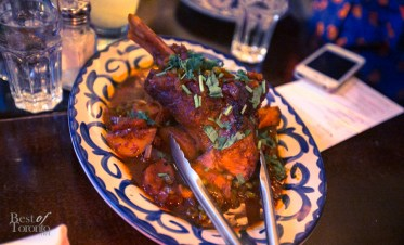 """Pierna De Cordero"" Braised lamb shanks with potatoes, spring peas in a guajillo, beer and mezcal sauce"
