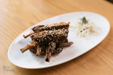 """Saucy Rib 'Nibblers"" made with Ontario lamb ribs, sweet hoisin BBQ sauce, sprinkles of sesame seed and celeriac slaw"